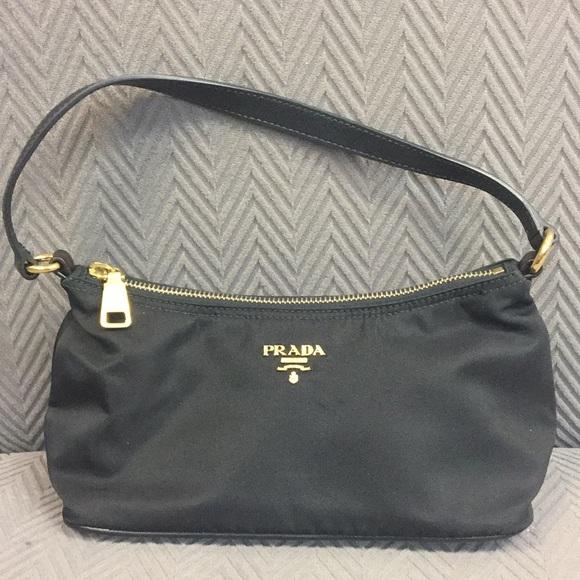 dcce90ec99ef Prada Tessuto And Saffiano Nylon Shoulder Pochette.  M 5a97f9ac9d20f068fa257a81. Other Bags ...